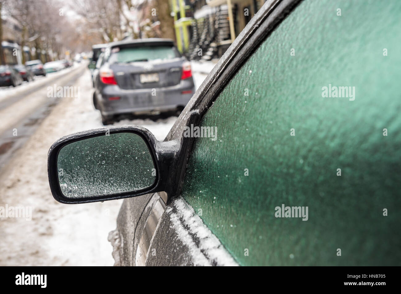 Montreal, CA, 29th February 2016. Car mirror and windows are covered with ice after freezing rain. - Stock Image