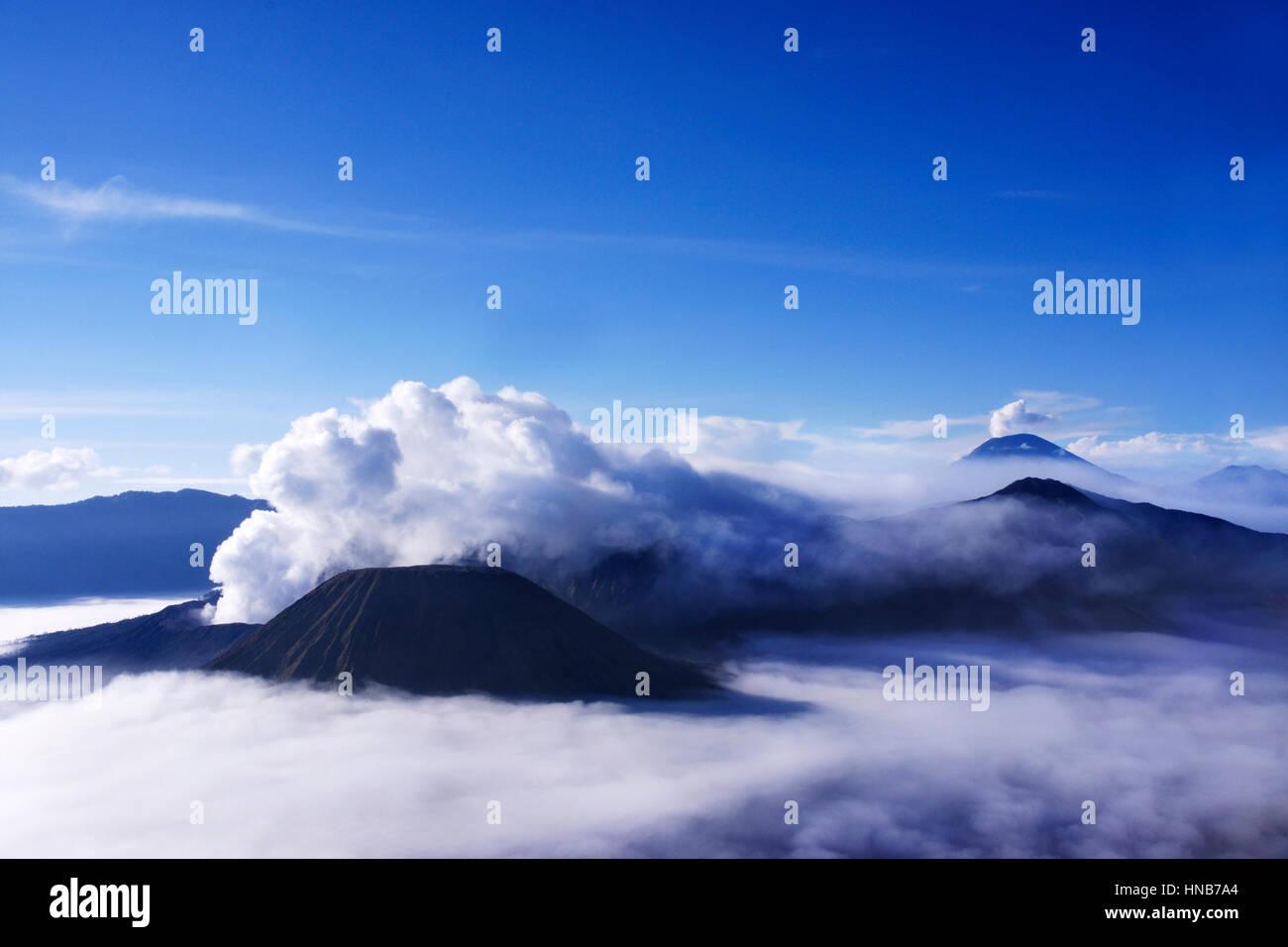 Volcanoes seen from Mount Penanjakan Indonesia. - Stock Image