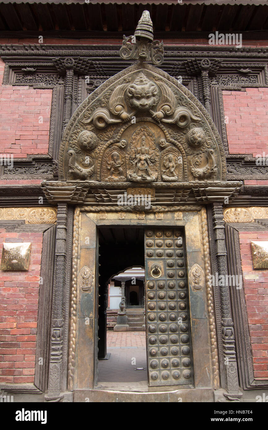 Ornately carved lintel of a traditional Nepalese-style wooden doorway in Bhaktapur, Kathmandu - Stock Image