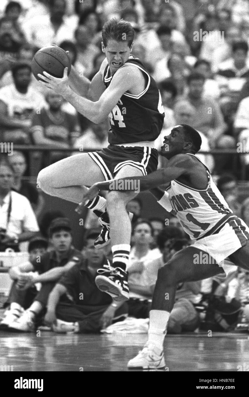Celtics Danny Ainge (left) and Pistons Isaiah Thomas (right) in action during the NBA playoffs in Detroit Michigan Stock Photo