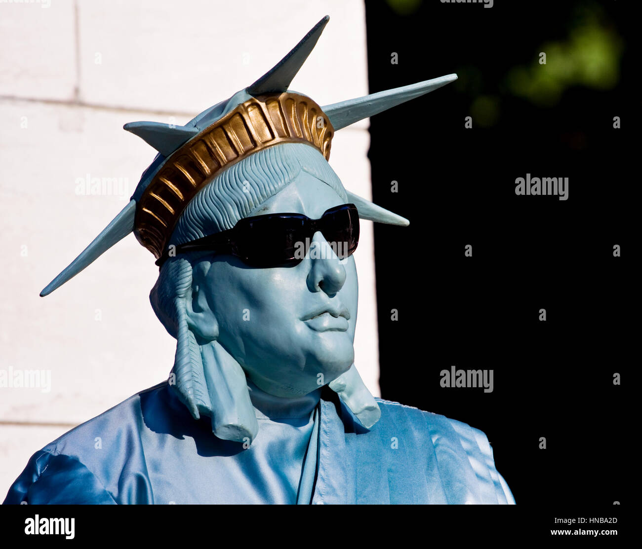 A street entertainer dressed up as the statue of liberty poses for tourists outside central Park in manhatten, New Stock Photo