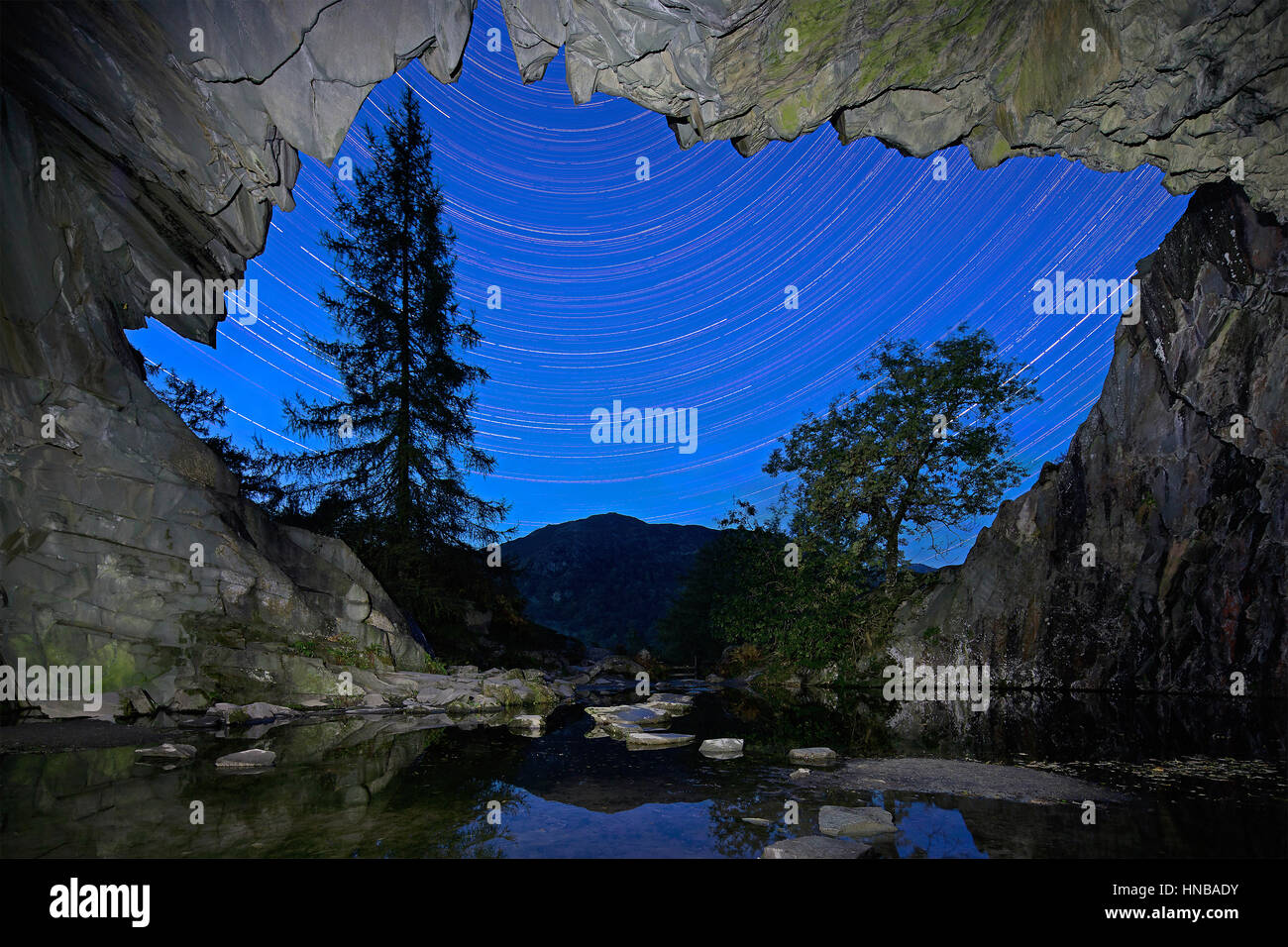 A view of the night sky looking out of Rydal Cave near Ambleside in The Lake District National Park in Cumbria, - Stock Image