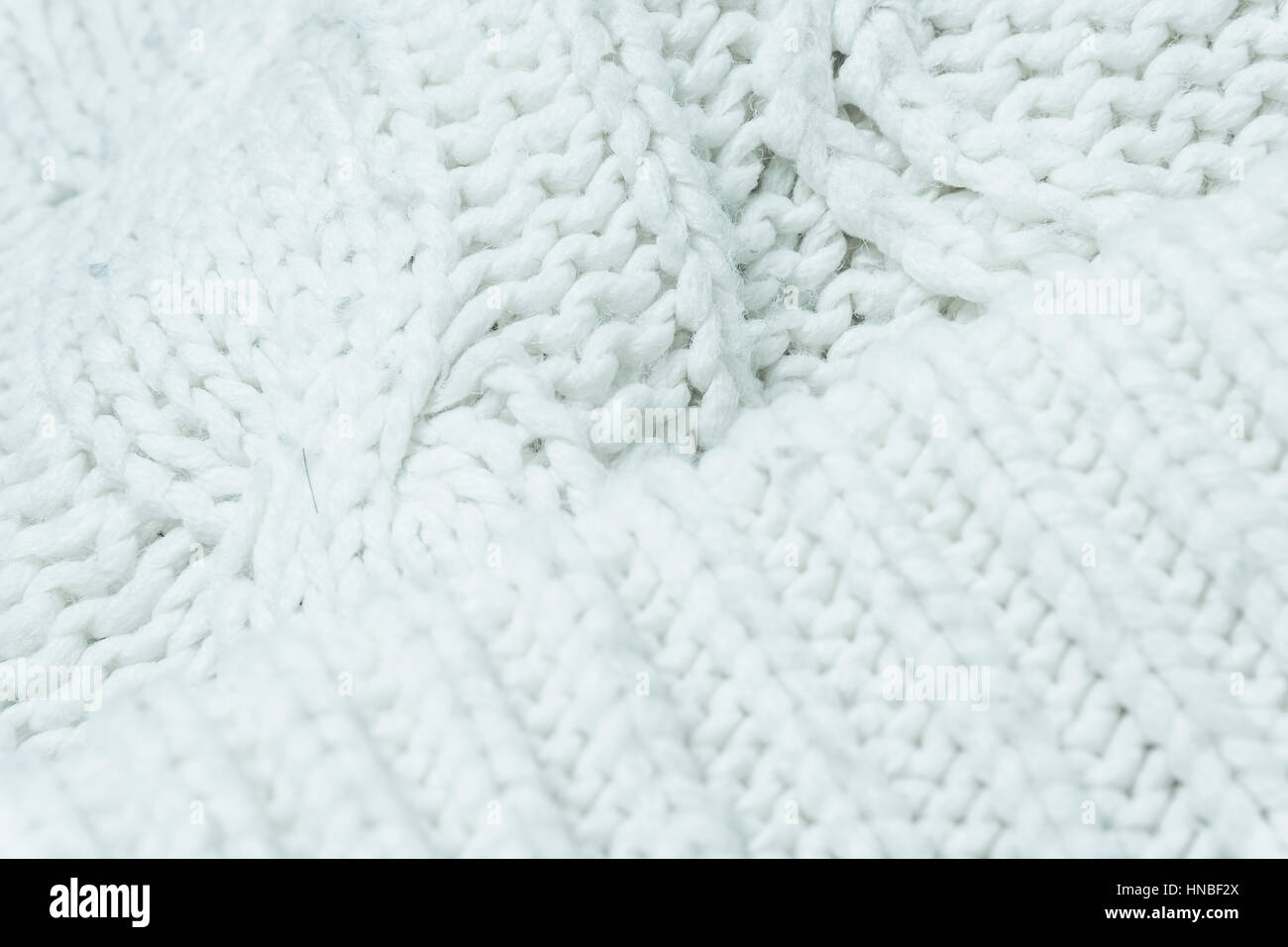 d8deec3ddabe8 knitted fabric texture. Knitted jersey background with a relief pattern.  Braids in knitting