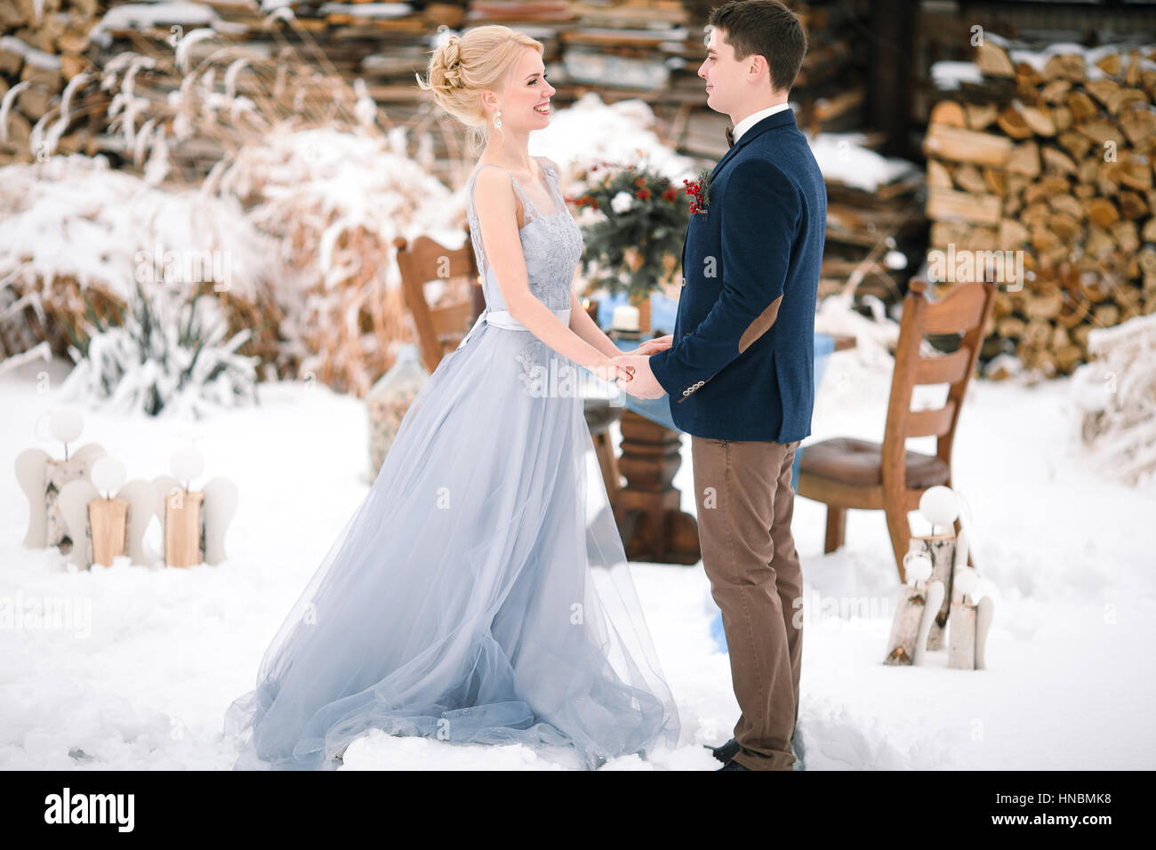Winter Wedding Outdoor On Snow And Firewood Background