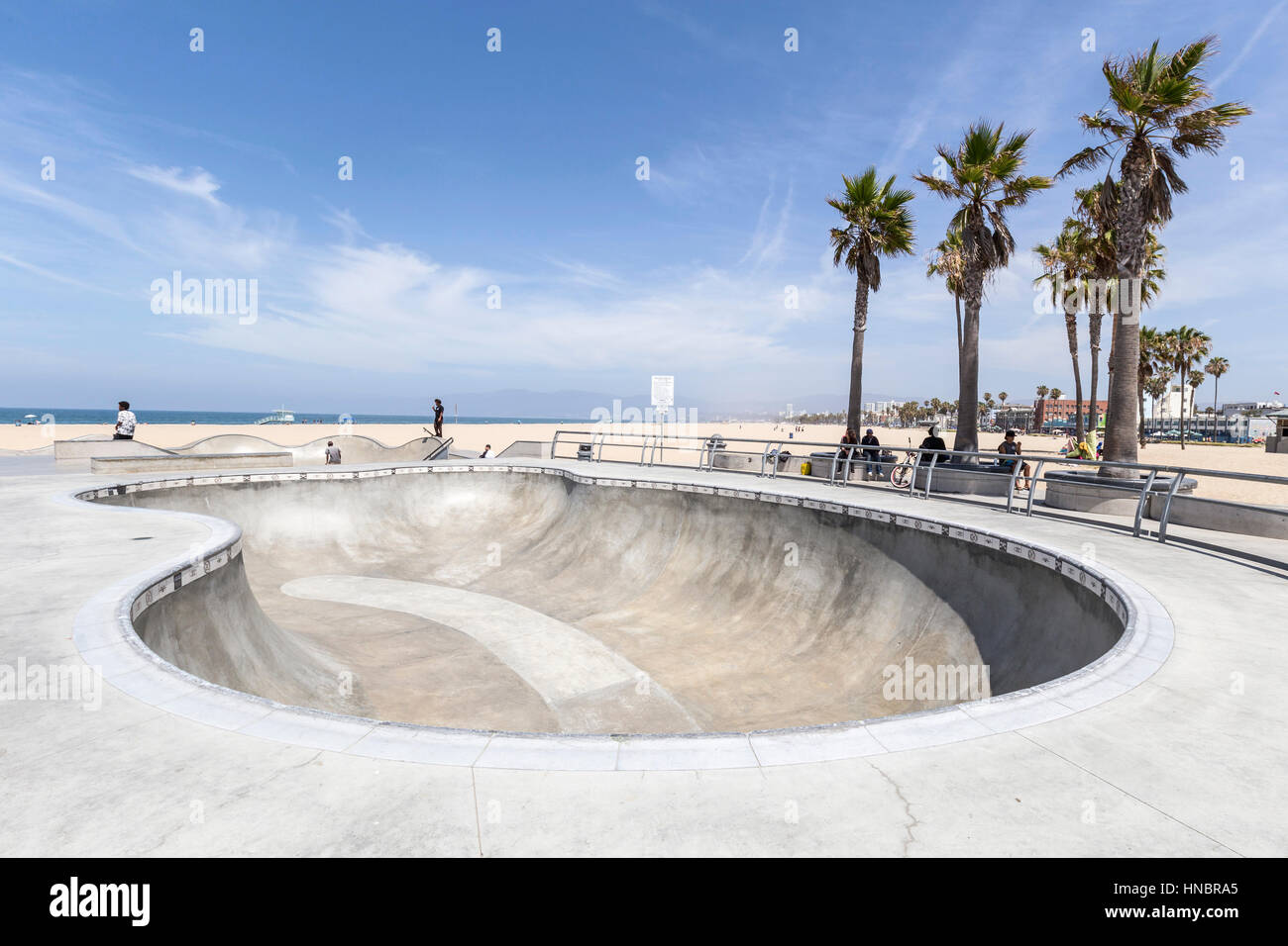 Editorial view of a concrete bowl at Los Angeles's ocean front Venice Beach skate board park. - Stock Image