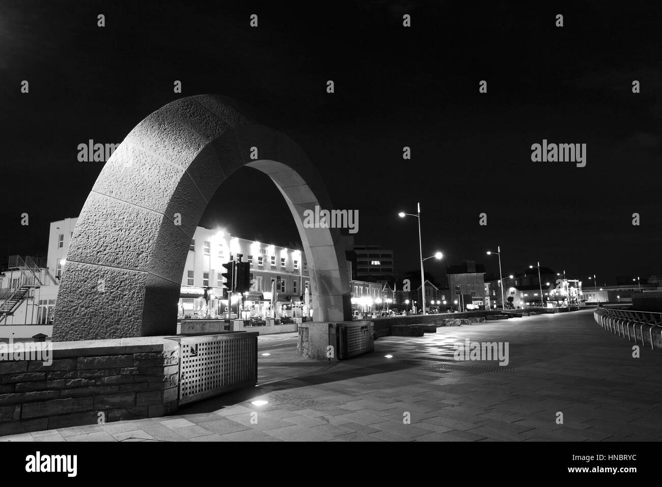 Stone Arch Sculpture at night, Weston Super Mare, Bristol Channel, Somerset County, England, UK - Stock Image