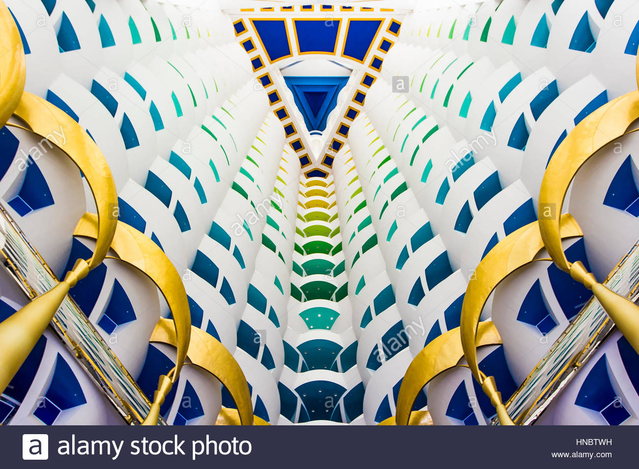 Looking straight up inside the ultra-modern, colorful atrium at the Burj Al Arab hotel. - Stock Image
