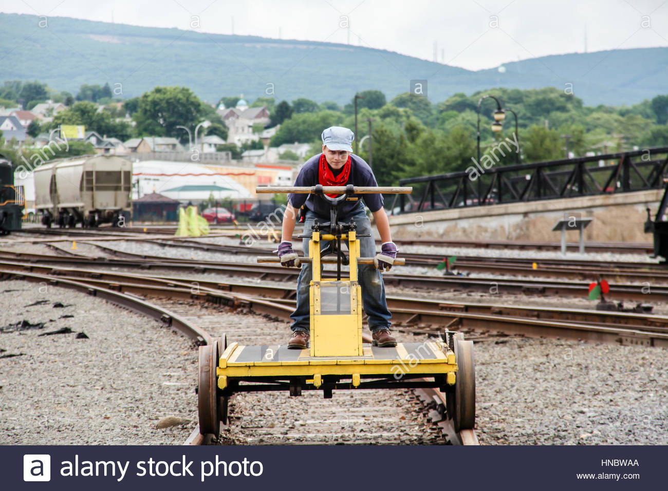 A docent demonstrates a man propelled hand car at Steamtown National Historic Site, a railroad museum and heritage - Stock Image