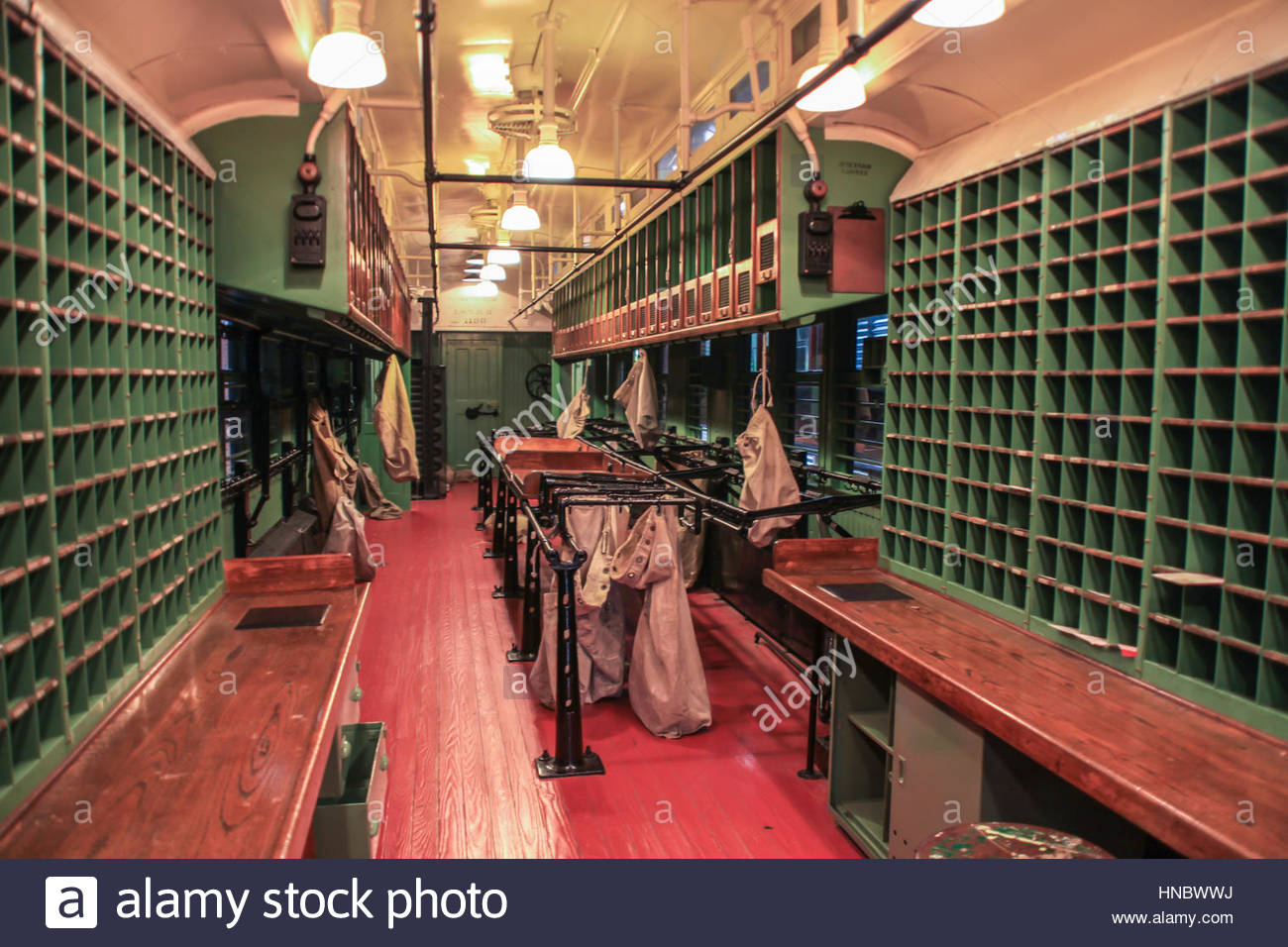 Interior of an early 20th-Century postal sorting car at the Steamtown National Historic Site. - Stock Image