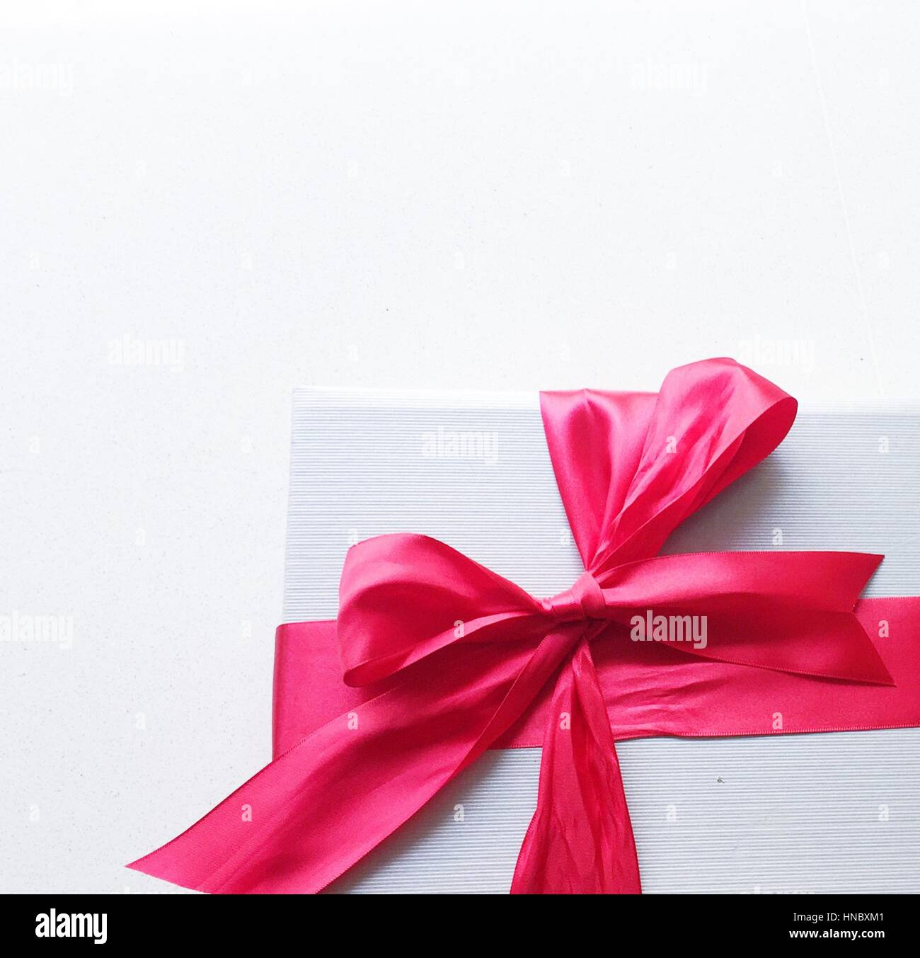Close-up of a gift wrapped with pink bow Stock Photo