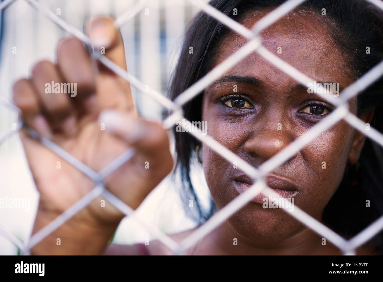Social issues, abuse and violence on women. Depressed girl, sad african american young woman crying at home. Abused - Stock Image
