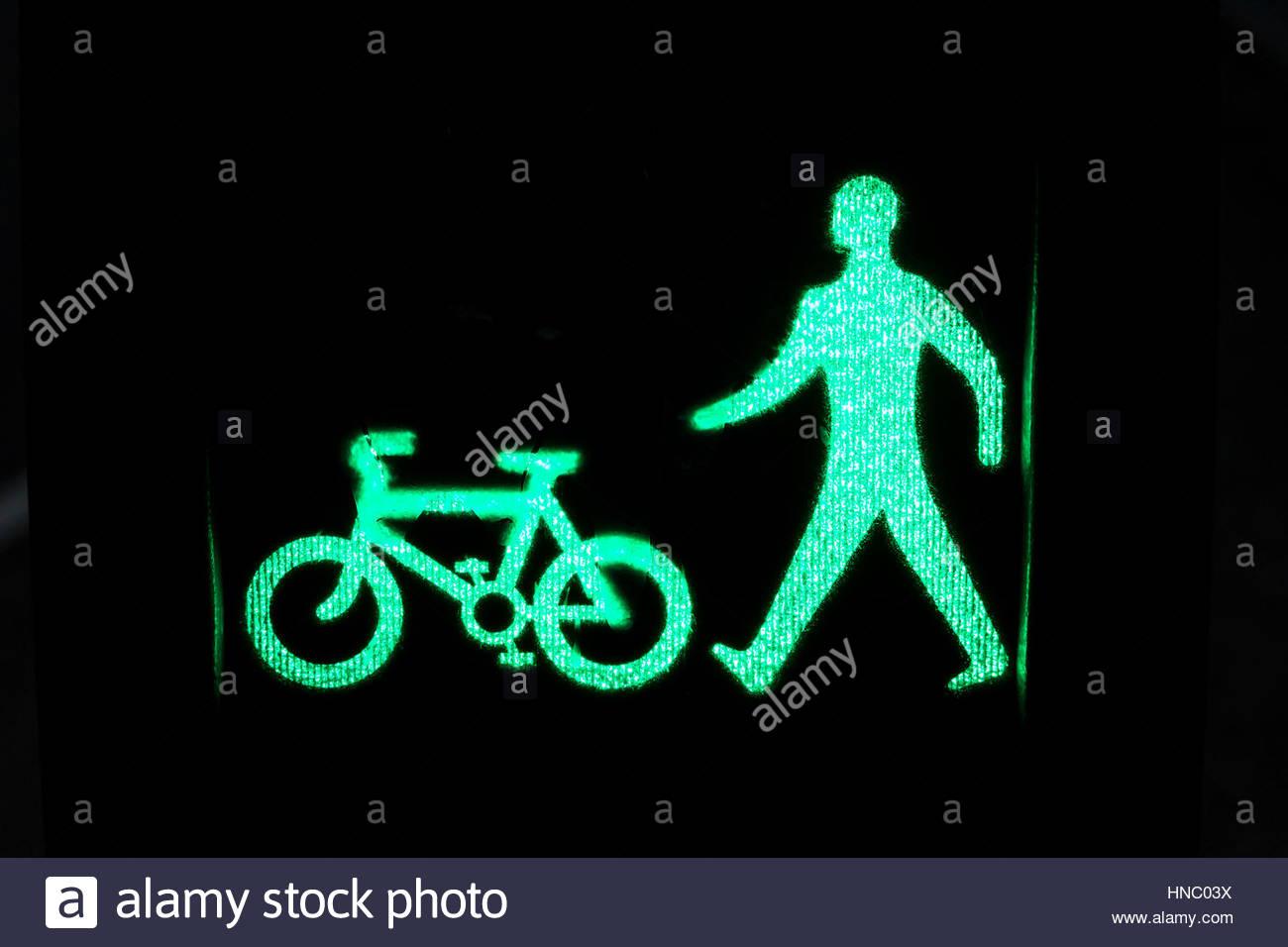 Illustrated pedestrian signal at crosswalk in Glasgow. - Stock Image