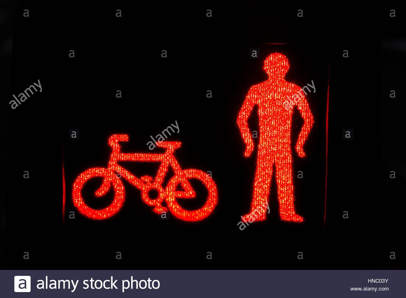 Illustrated pedestrian signal at crosswalk, Glasgow. - Stock Image