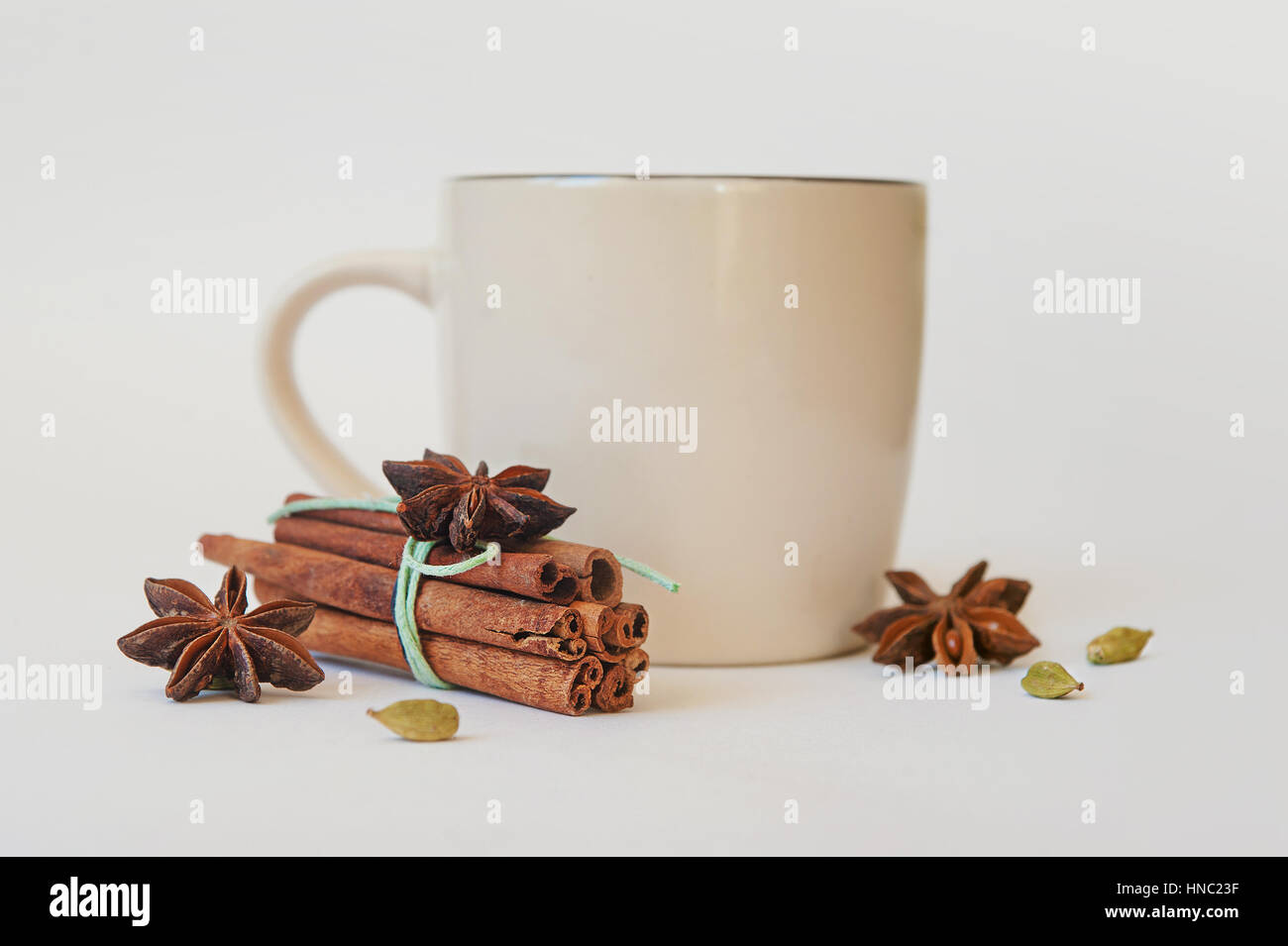 a few anise stars, cassia cinnamon sticks, dried orange rings and fruit tea on the tablecloth - Stock Image