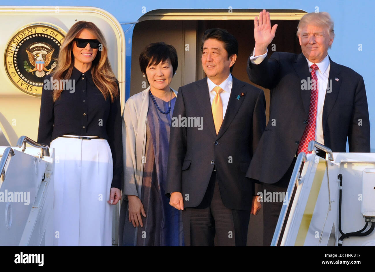 West Palm Beach, Florida, USA. 10th Feb, 2017. U.S. President Donald Trump (R) waves after arriving on Air Force - Stock Image
