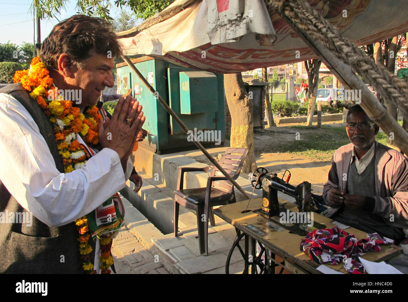 Uttar Pradesh, India. 8th Feb, 2017. KK Sharma (l), candidate of the Indian National Congress party, visits potential - Stock Image