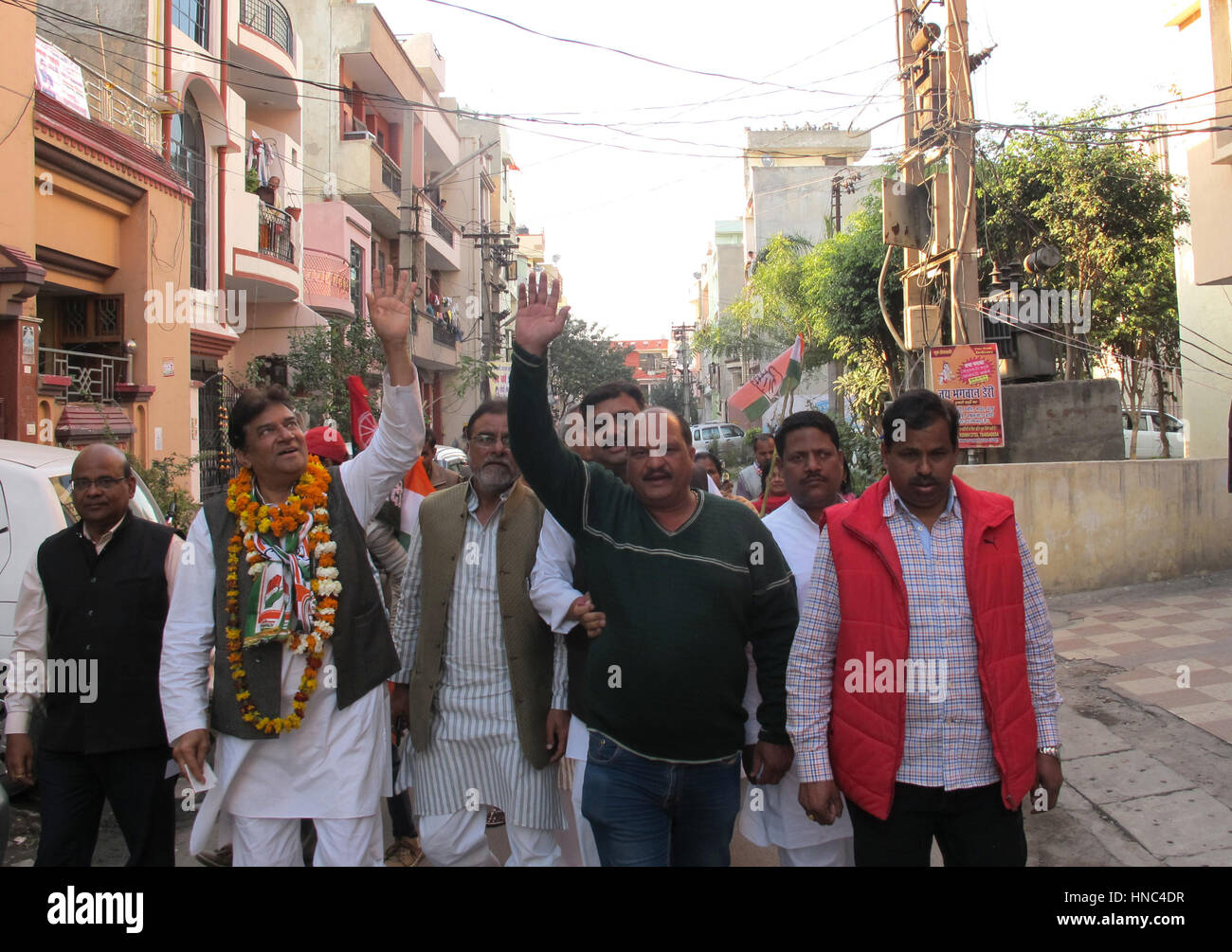 Uttar Pradesh, India. 8th Feb, 2017. KK Sharma (2nd l), candidate of the Indian National Congress party, visits - Stock Image