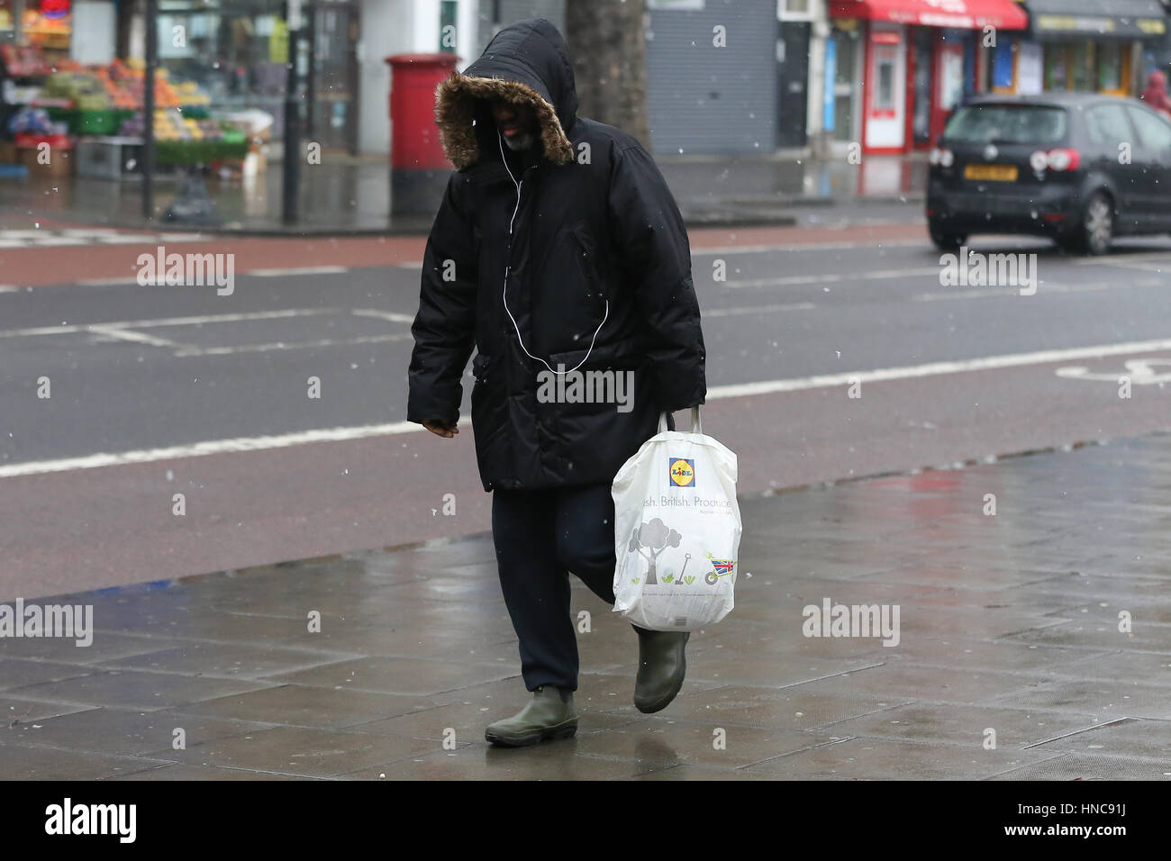 North London, UK. 11th Feb, 2017. Shoppers out in the rain and sleet showers in North London. Credit: Dinendra Haria/Alamy Stock Photo