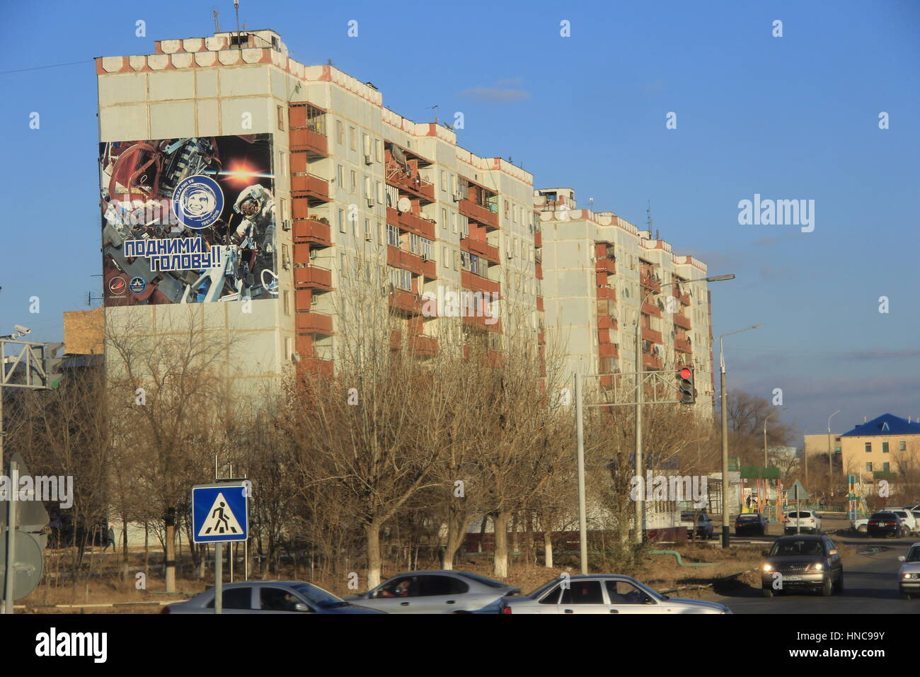 Baikonur, Kazakhstan. 13th Nov, 2016. View of an apartment building with a wall painting relating to space travel - Stock Image