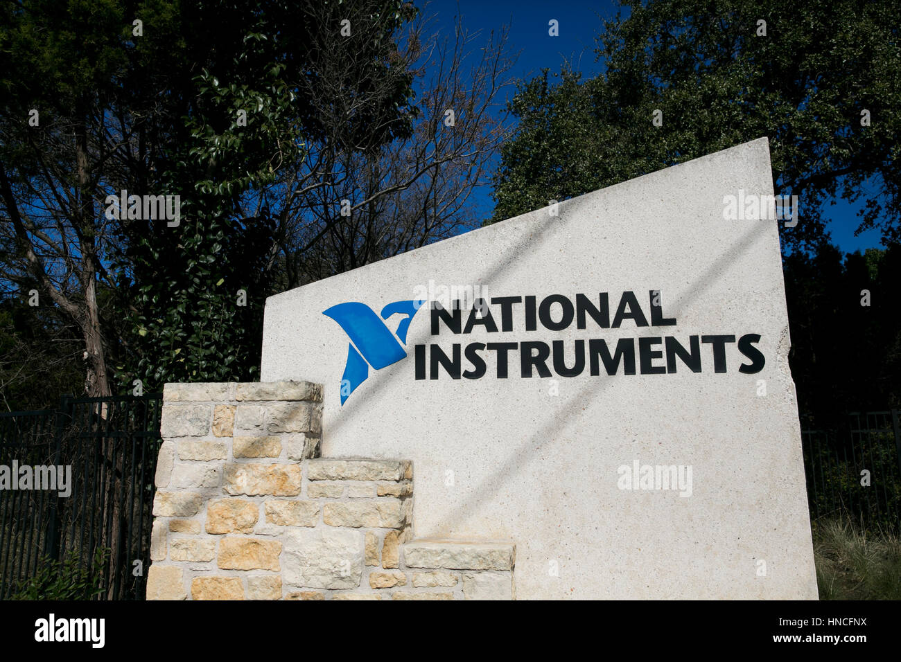 A logo sign outside of the headquarters of the National Instruments Corporation in Austin, Texas on January 28, - Stock Image