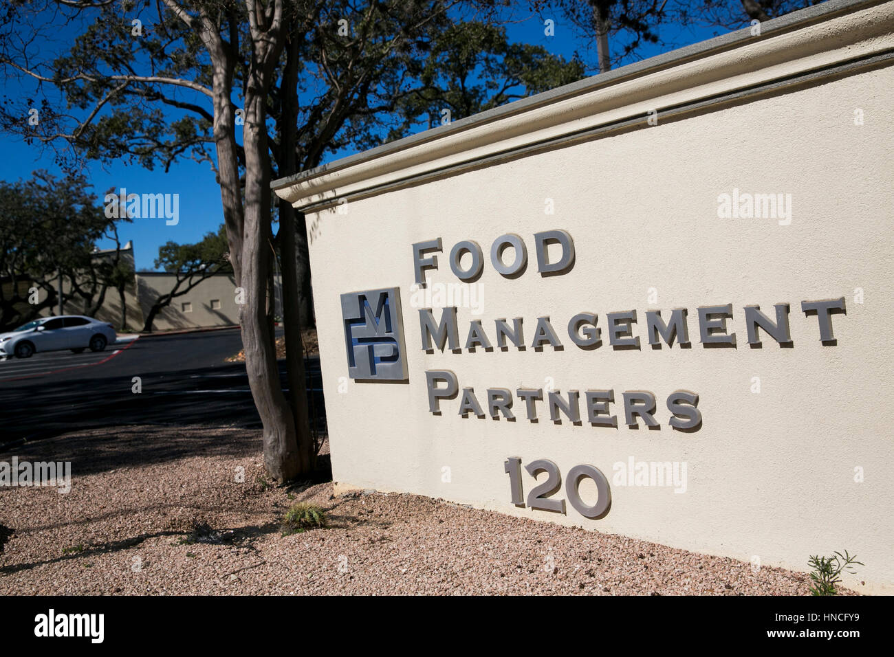 A logo sign outside of the headquarters of Food Management Partners in San Antonio, Texas on January 29, 2017. - Stock Image