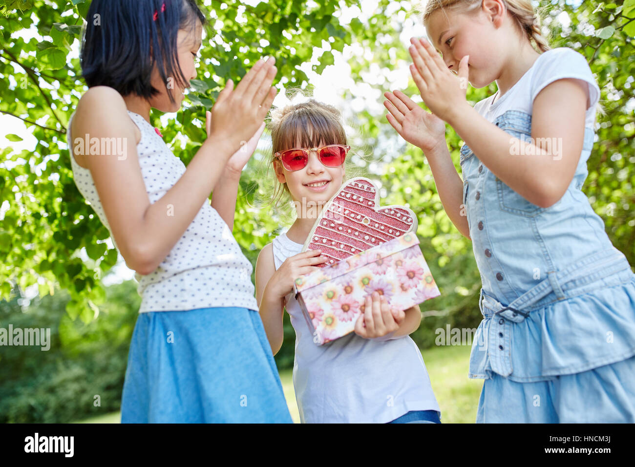 Applause for birthday girl at birthday party - Stock Image