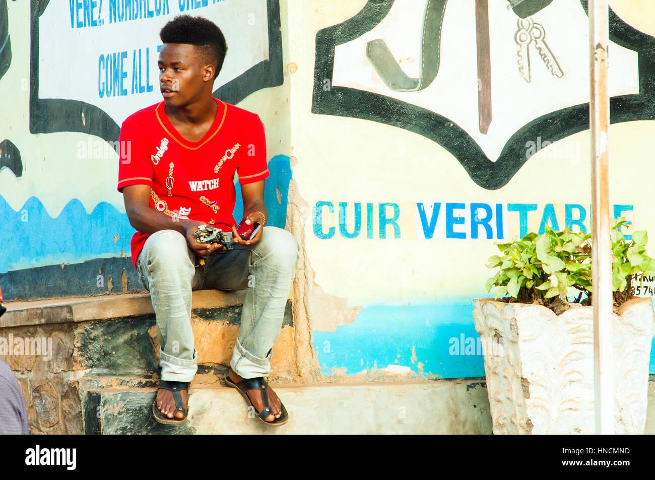 Young man in main street, Nyamirambo, Kigali, Rwanda Stock Photo