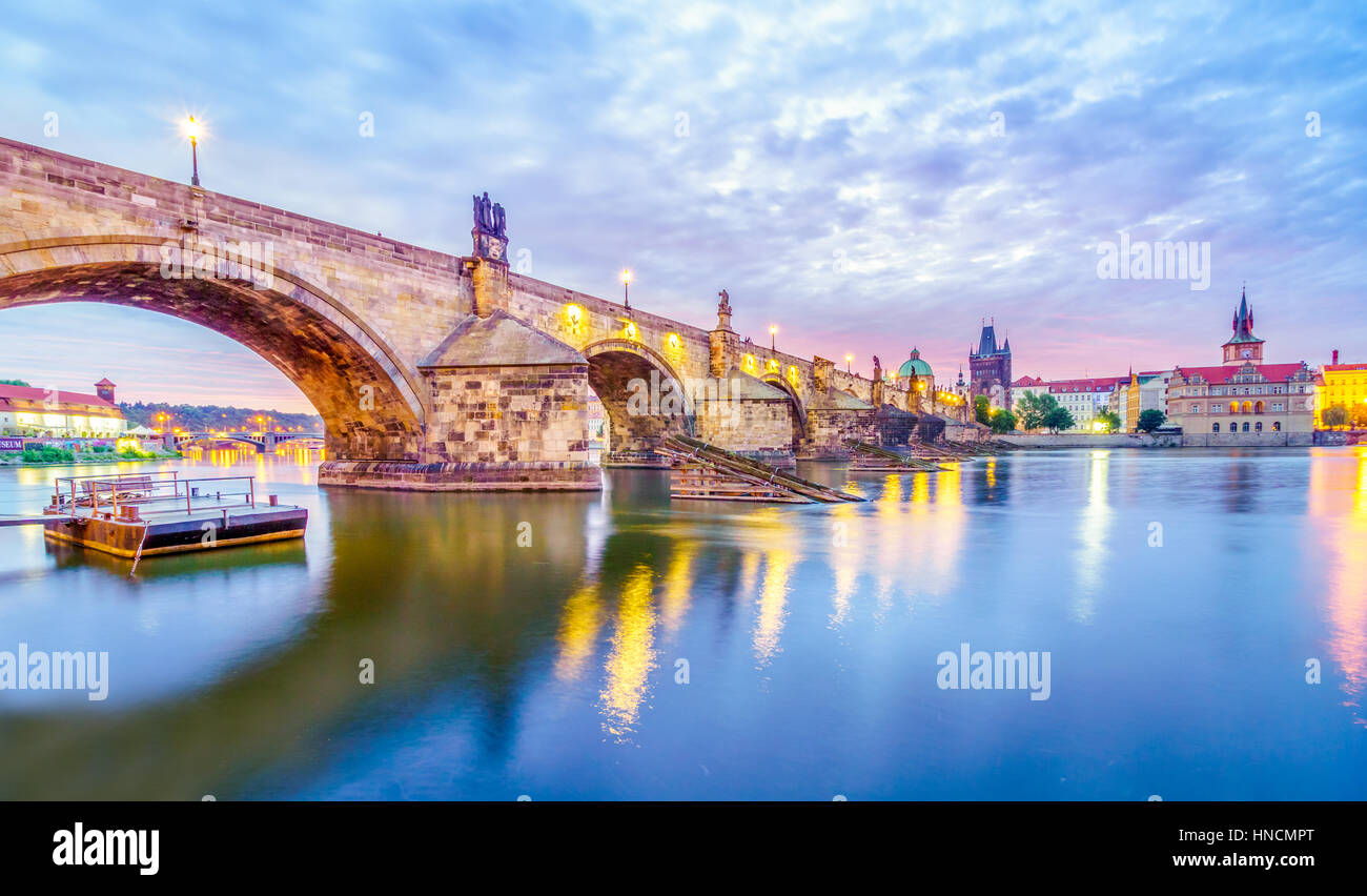 The Charles bridge is located in Prague, Czech Republic. Finished in the XV century, it is a medieval gothic bridge - Stock Image