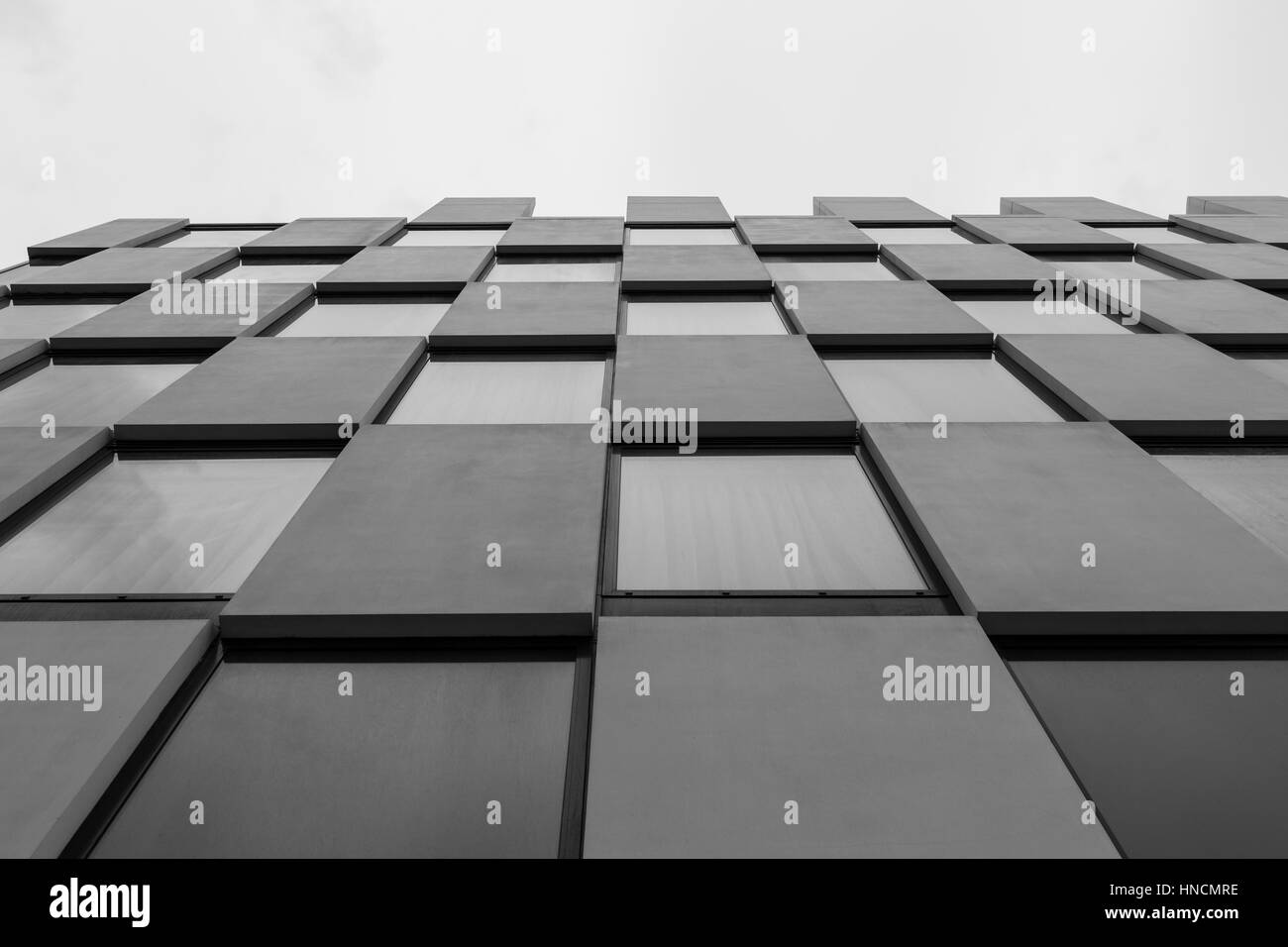 Urban Geometry, looking up to glass and concrete building. Modern architecture black and white, glass and steel. - Stock Image