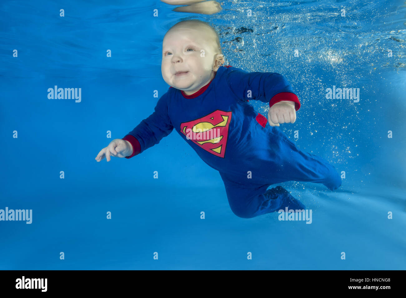 96e80ea3a7e7c Litle boy in Superman costume posing under water in swimming pool, Odessa,  Ukraine