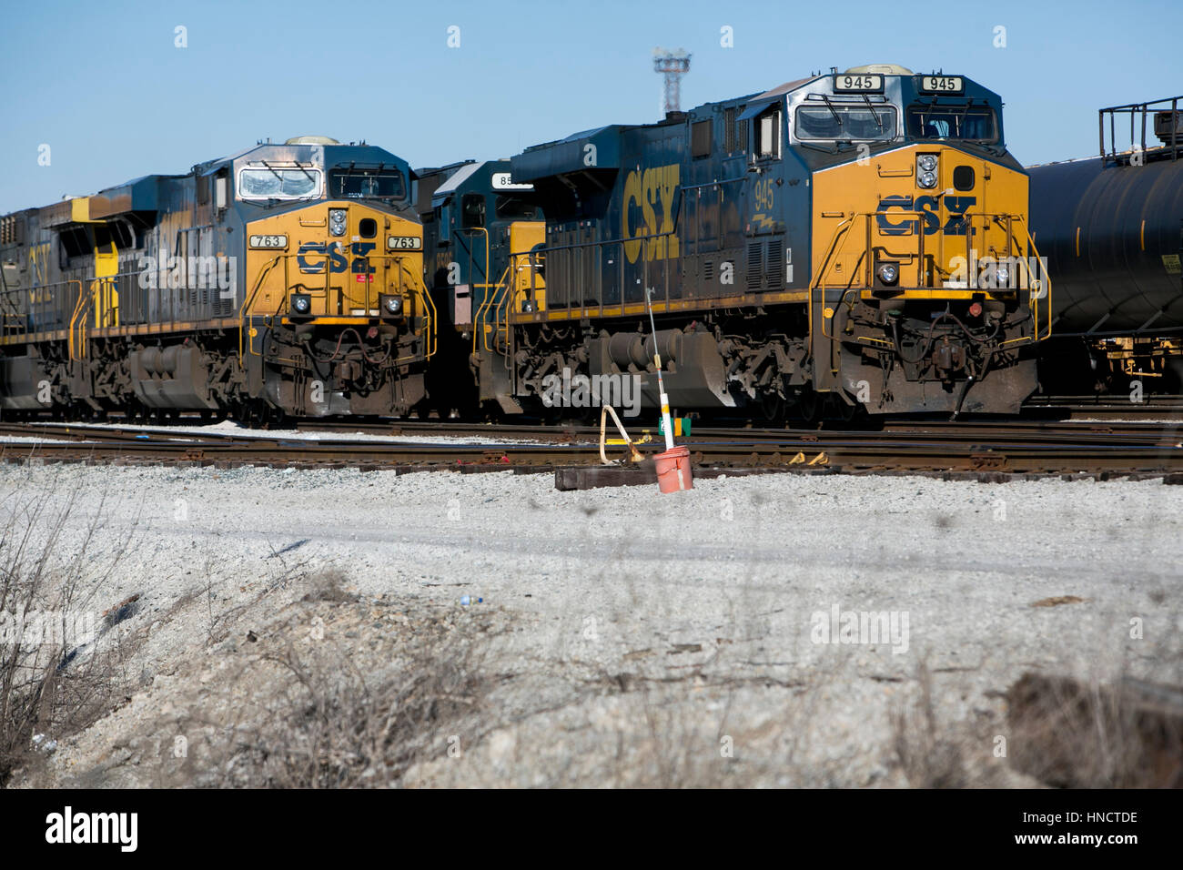 Csx Locomotives And Train Cars On A Railroad Siding In