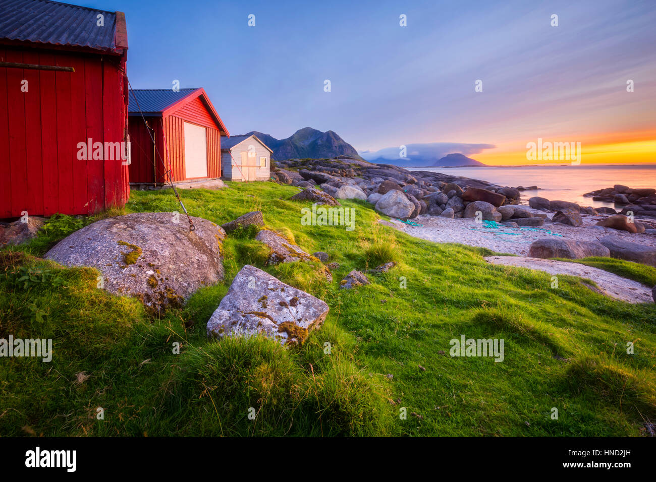 Brenna Boat Sheds at sunset - Stock Image