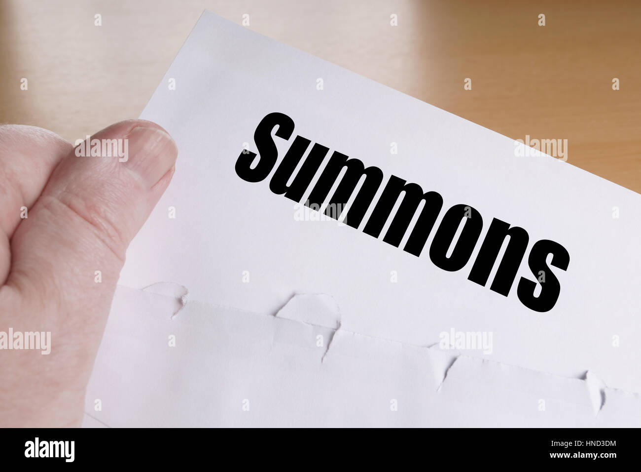 hand holding summons letter - Stock Image