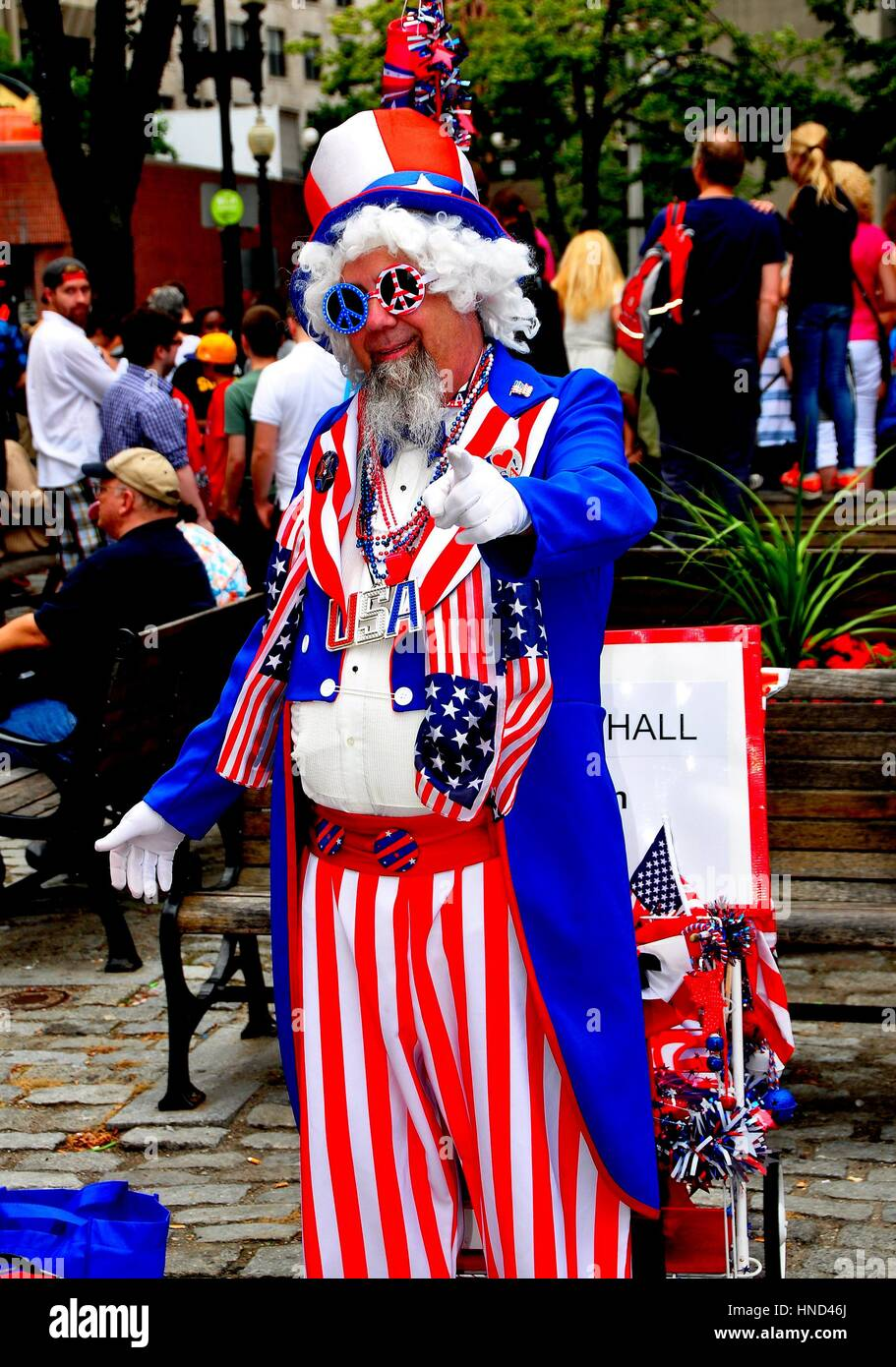 Boston, Massachusetts - July 12, 2013:   Man dressed as Uncle Sam at Quincy Market entices tourists to pose for - Stock Image