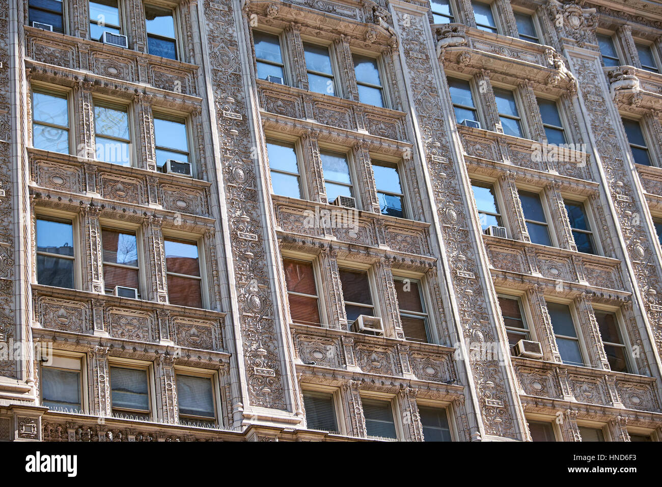 Terra cotta facade in french renaissance style with  elaborate decorations around windows and balconies of a  building - Stock Image