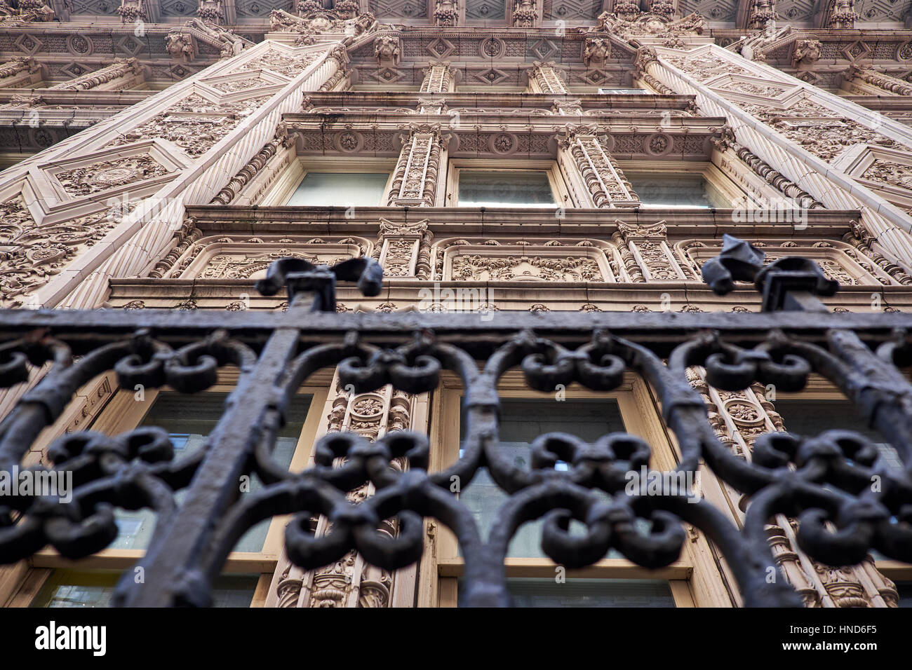 Close up of a terra cotta facade in french renaissance style with elaborate decorations around the windows on a - Stock Image