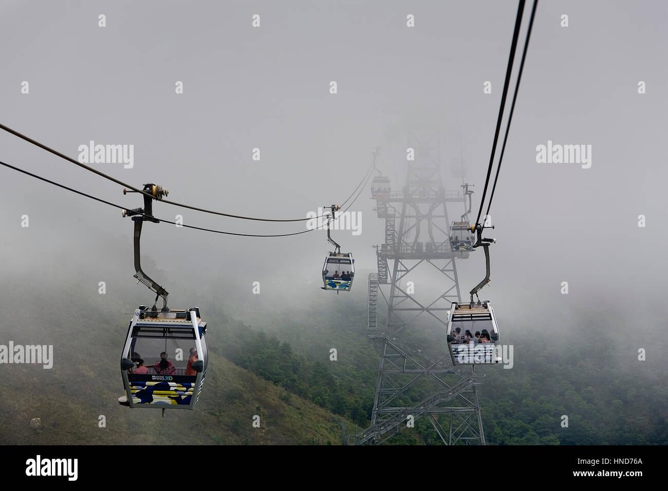 Fog, foggy, Cable car from Tung Chung to Po Lin Monastery. Lantau Island,Hong Kong, China - Stock Image