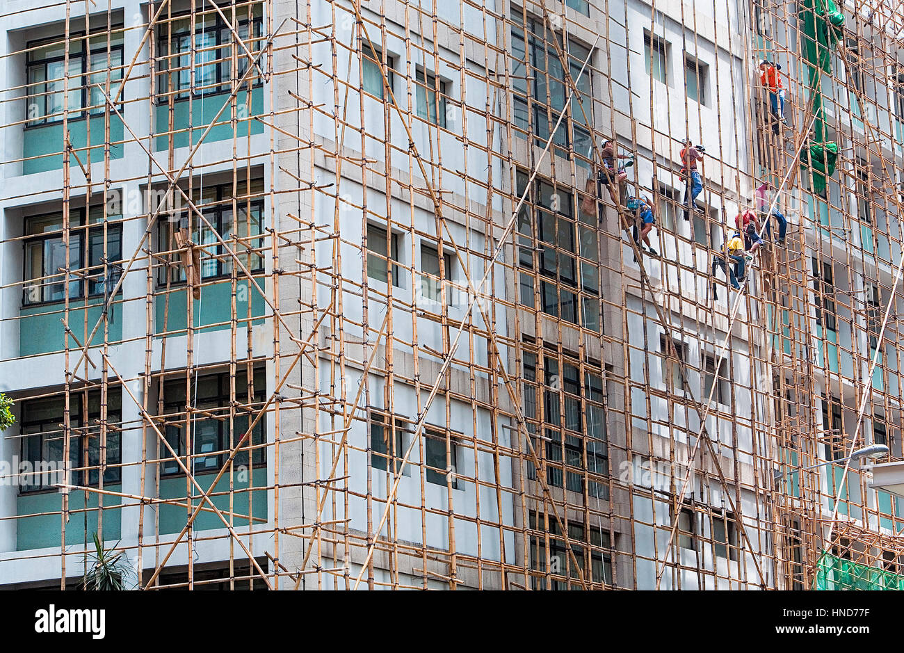 At work, Construction workers in Bamboo Scaffolding,Hong Kong, China - Stock Image