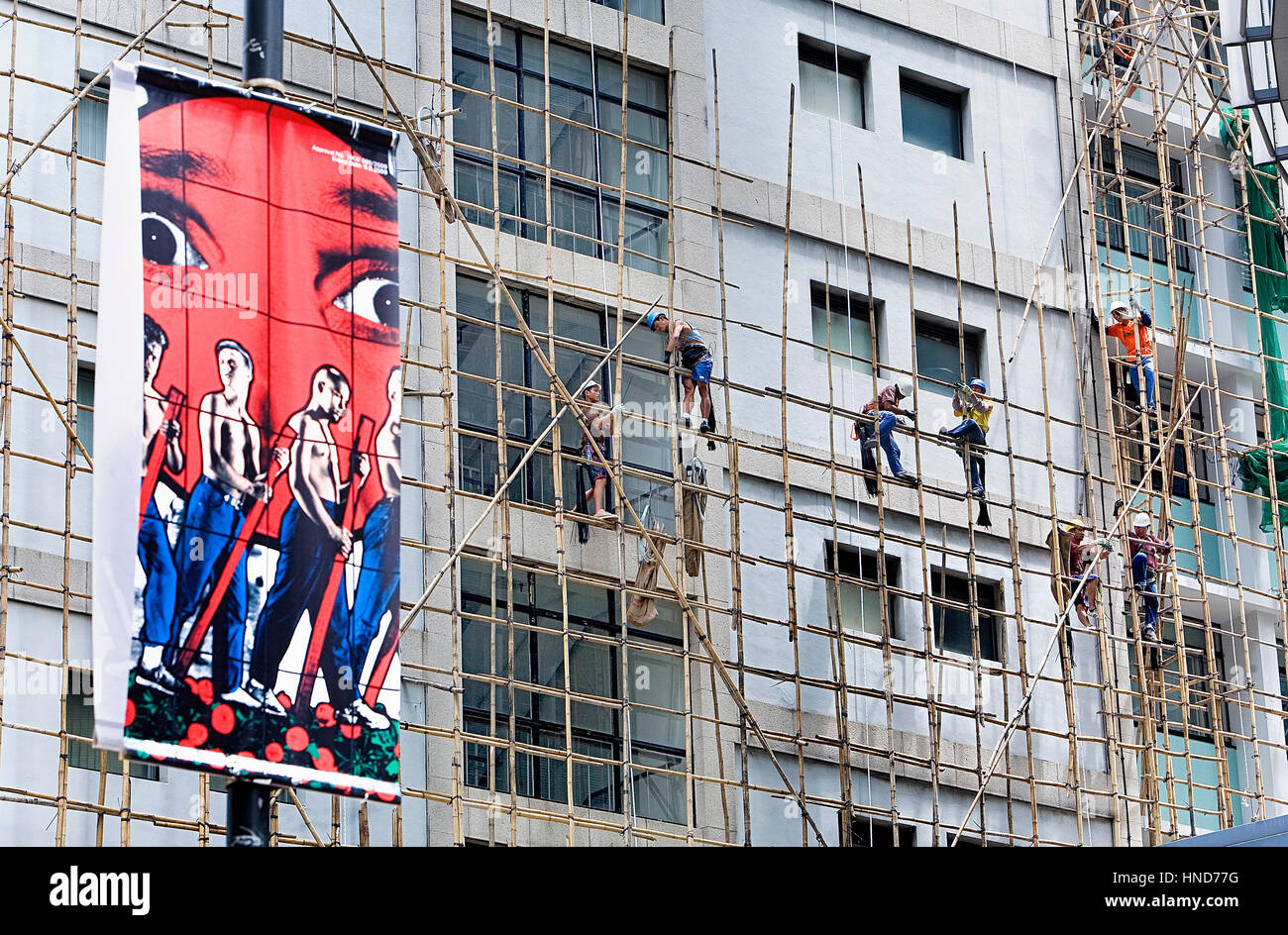 At work, Construction workers in Bamboo Scaffolding,Hong Kong, China Stock Photo