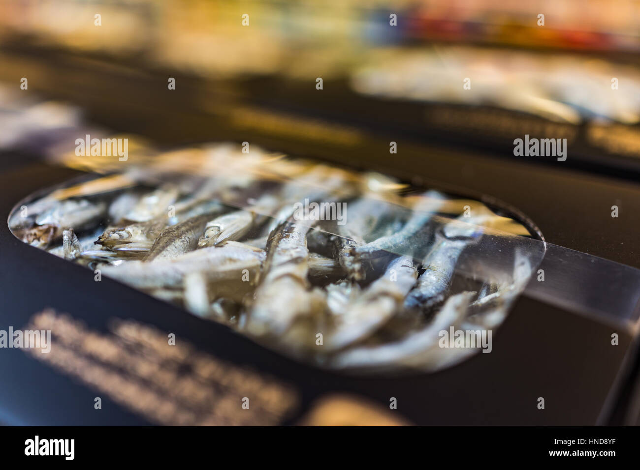 Macro closeup of box with dried anchovies - Stock Image