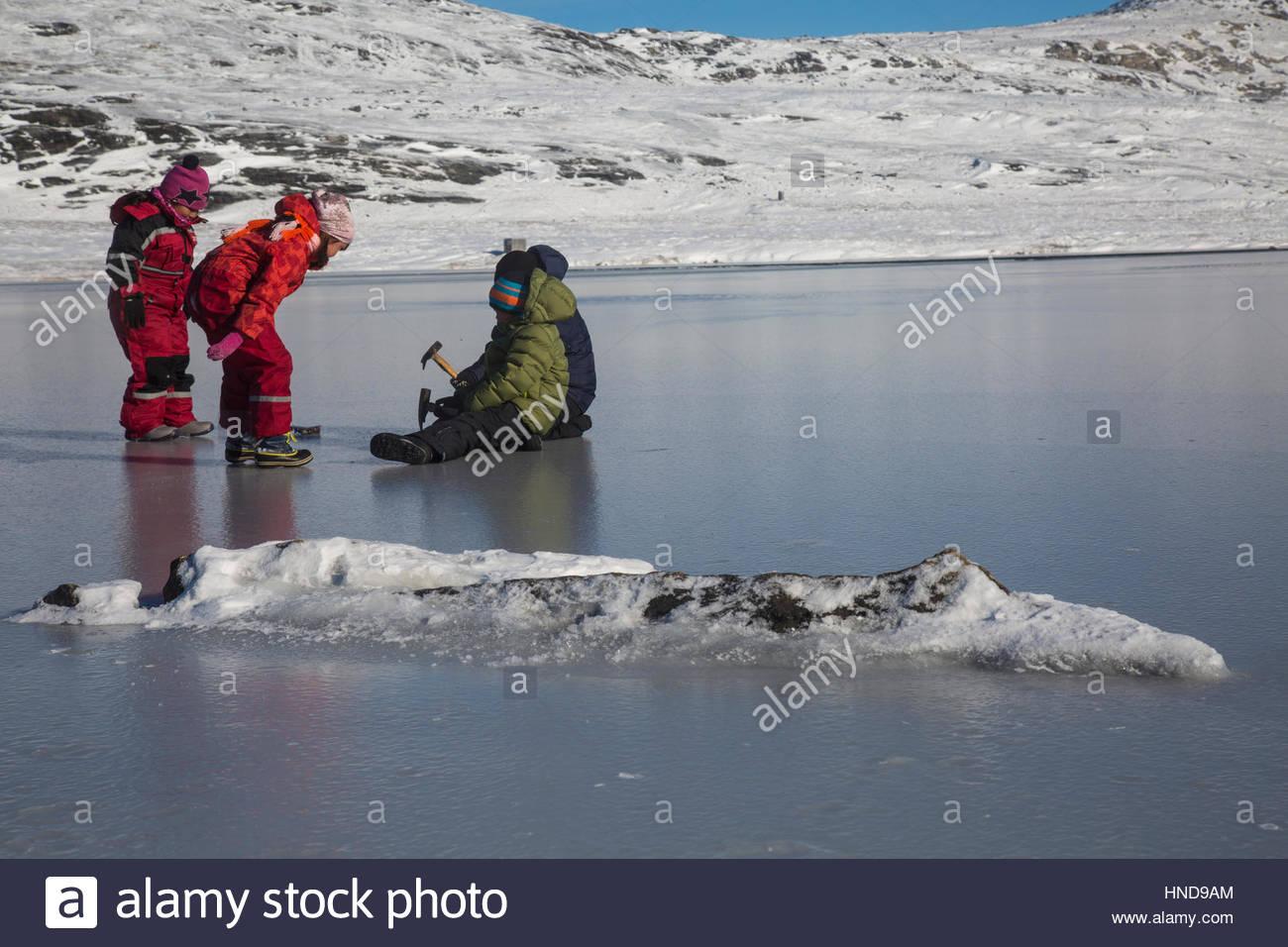 Greenlandic Children Playing on Ice - Stock Image