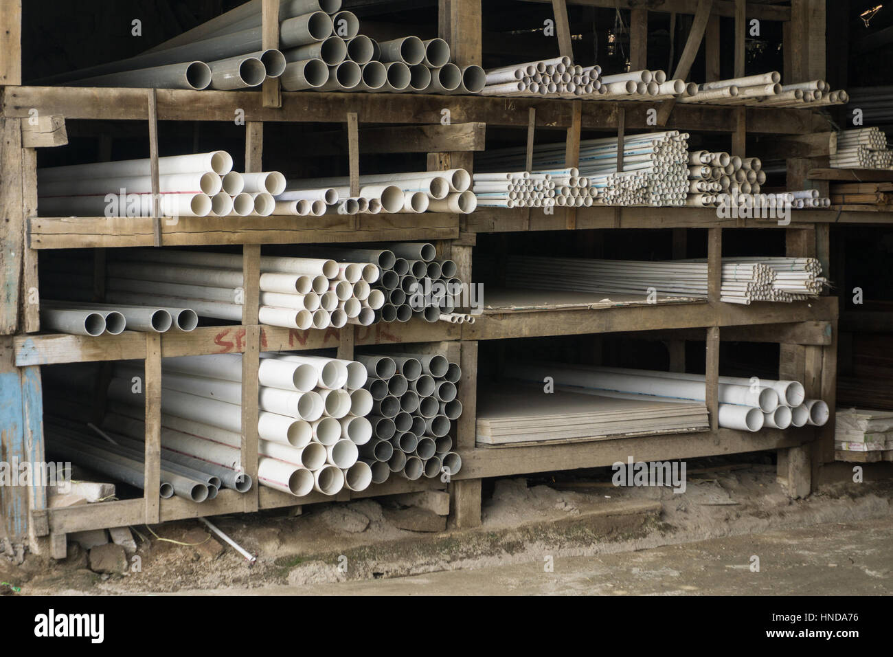 Various kind of pipes displayed on a steel rack inn a material and building store photo taken in Bogor Indonesia - Stock Image