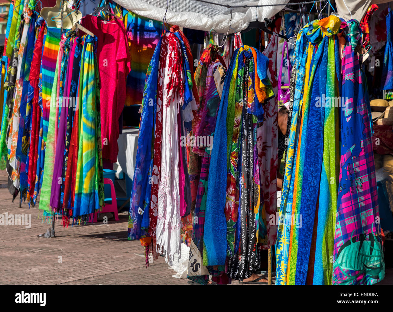 Brightly coloured (colored) scarves on a market stall, Marigot, Saint Martin Stock Photo