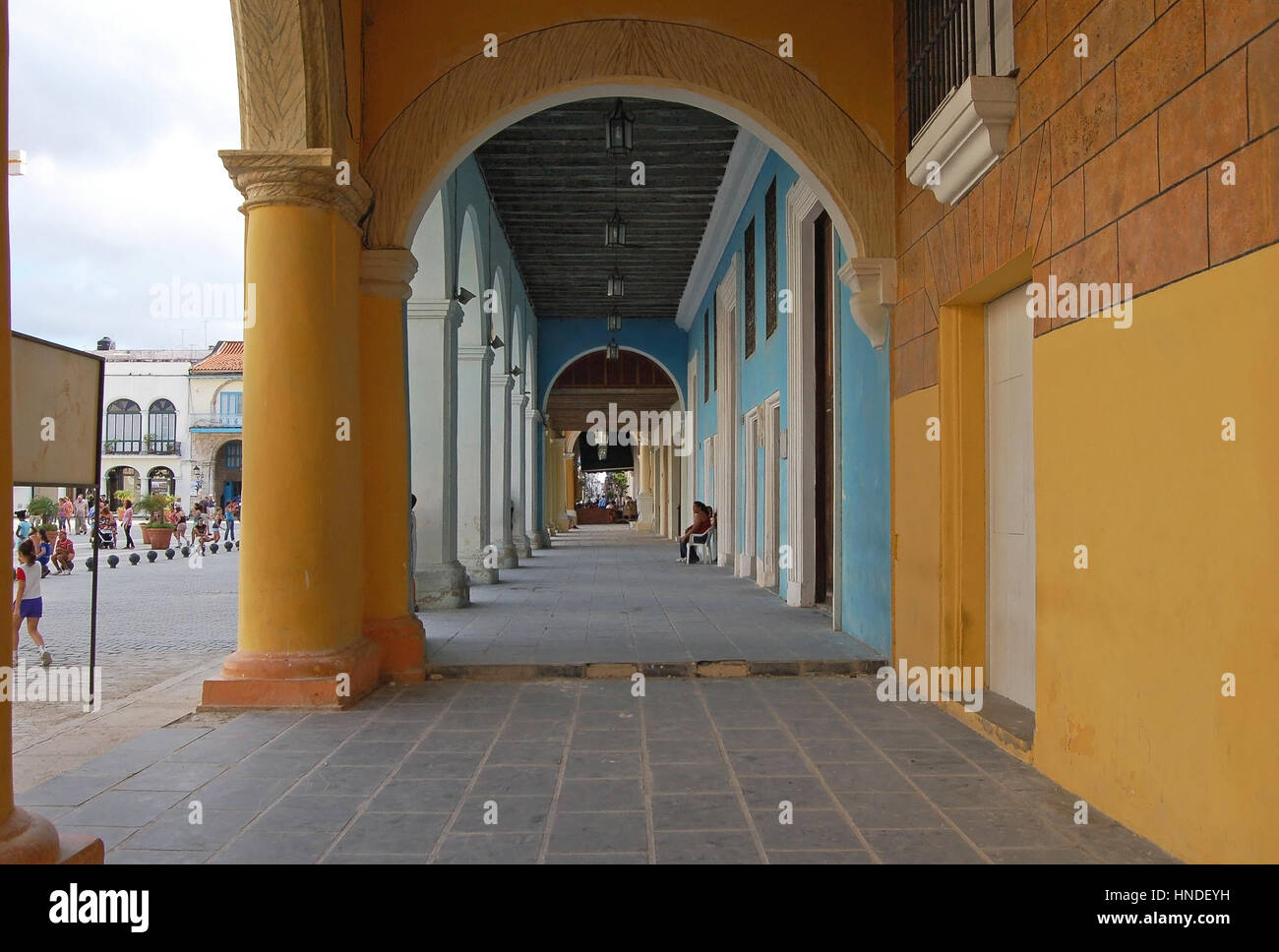 View along the Continuous Portico of the West Side of Plaza Vieja, Havana, Cuba - Stock Image