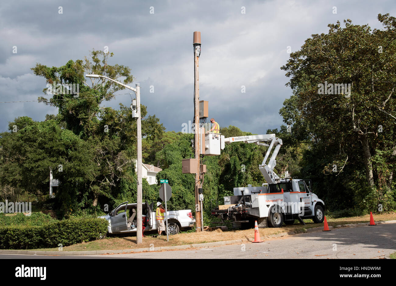 Fiber optics engineers working at Fairhope in Baldwin County Alabama USA - Stock Image
