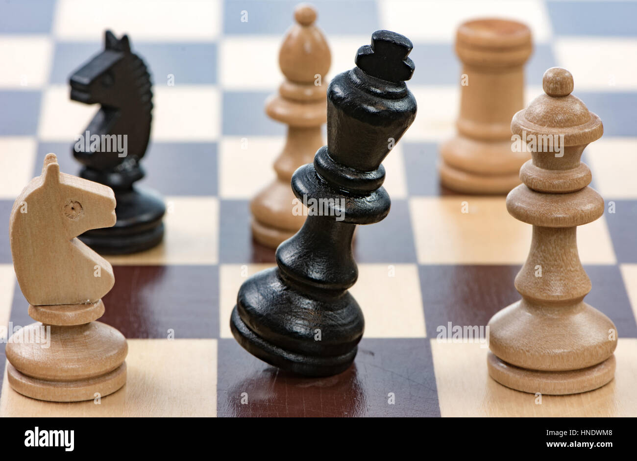 Checkmate - Game of chess with a falling king. Selective focus. - Stock Image