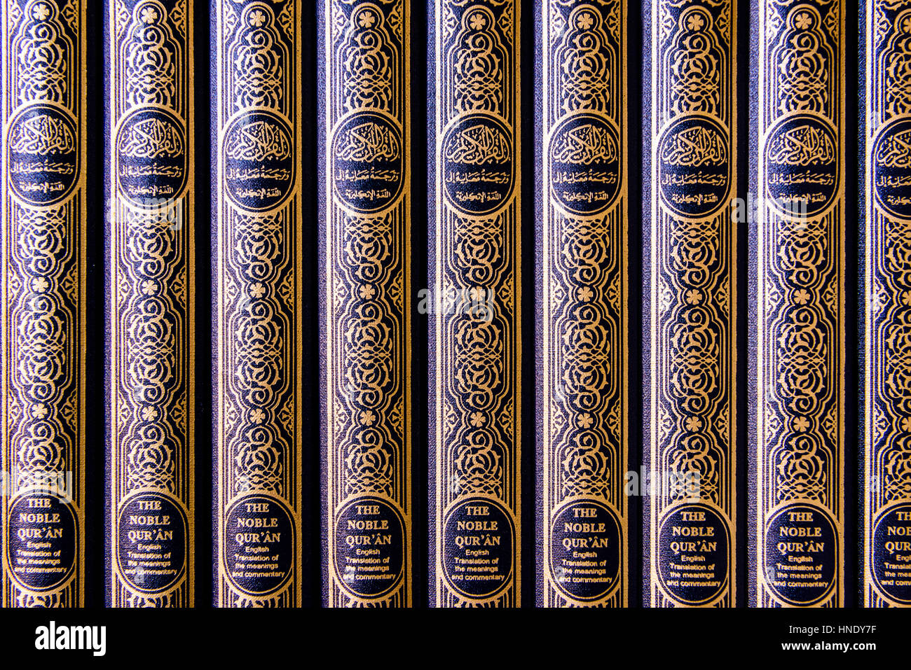 Copies of the Holy Qu'ran on shelves in a Mosque. - Stock Image