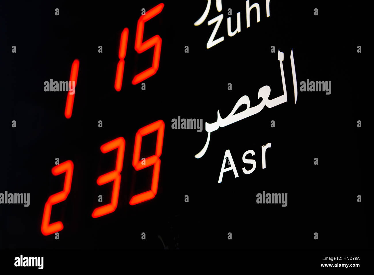 Electronic display board showing Prayer times in a Mosque Stock