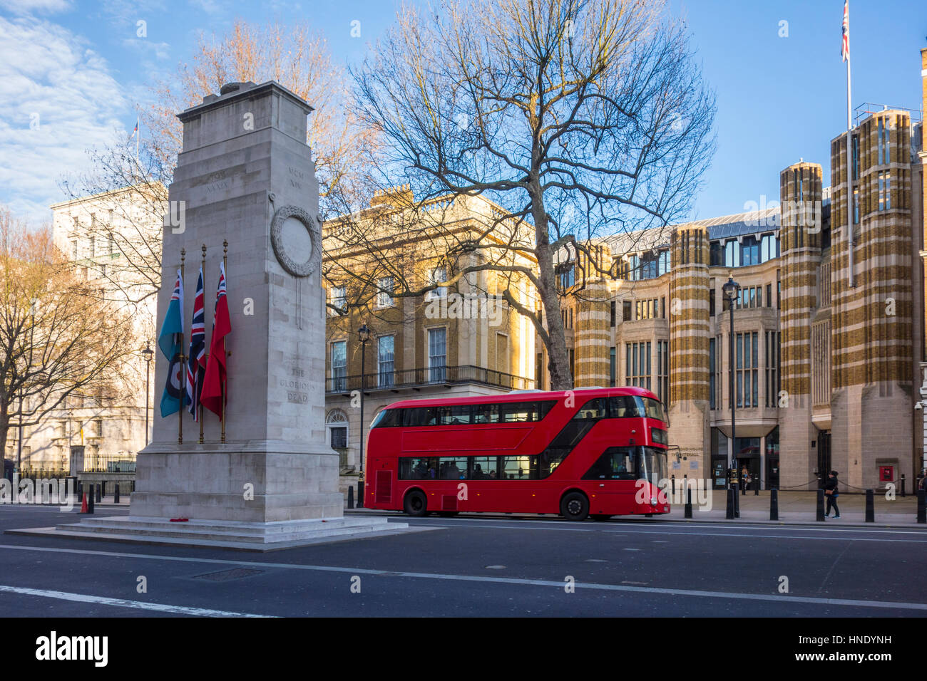 New routemaster red bus next to the Cenotaph on Whitehall. London, UK - Stock Image