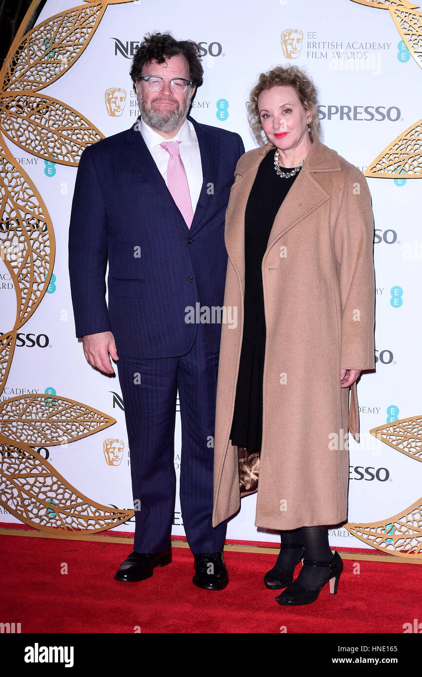 Kenneth Lonergan (left) and partner J. Smith-Cameron attending the EE British Academy Film Awards Nespresso Nominees' - Stock Image
